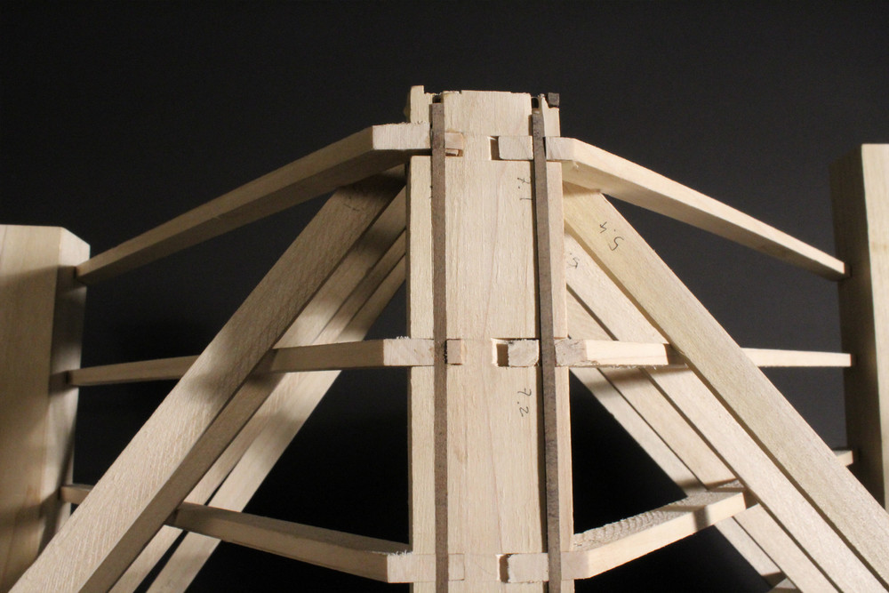 All pieces are held in place with locking splines, or miter joints secured with dowels