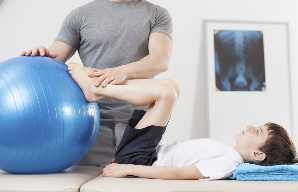 websitestock-photo-83958133-physical therapist working with young athlete at mana physical therapy.jpg