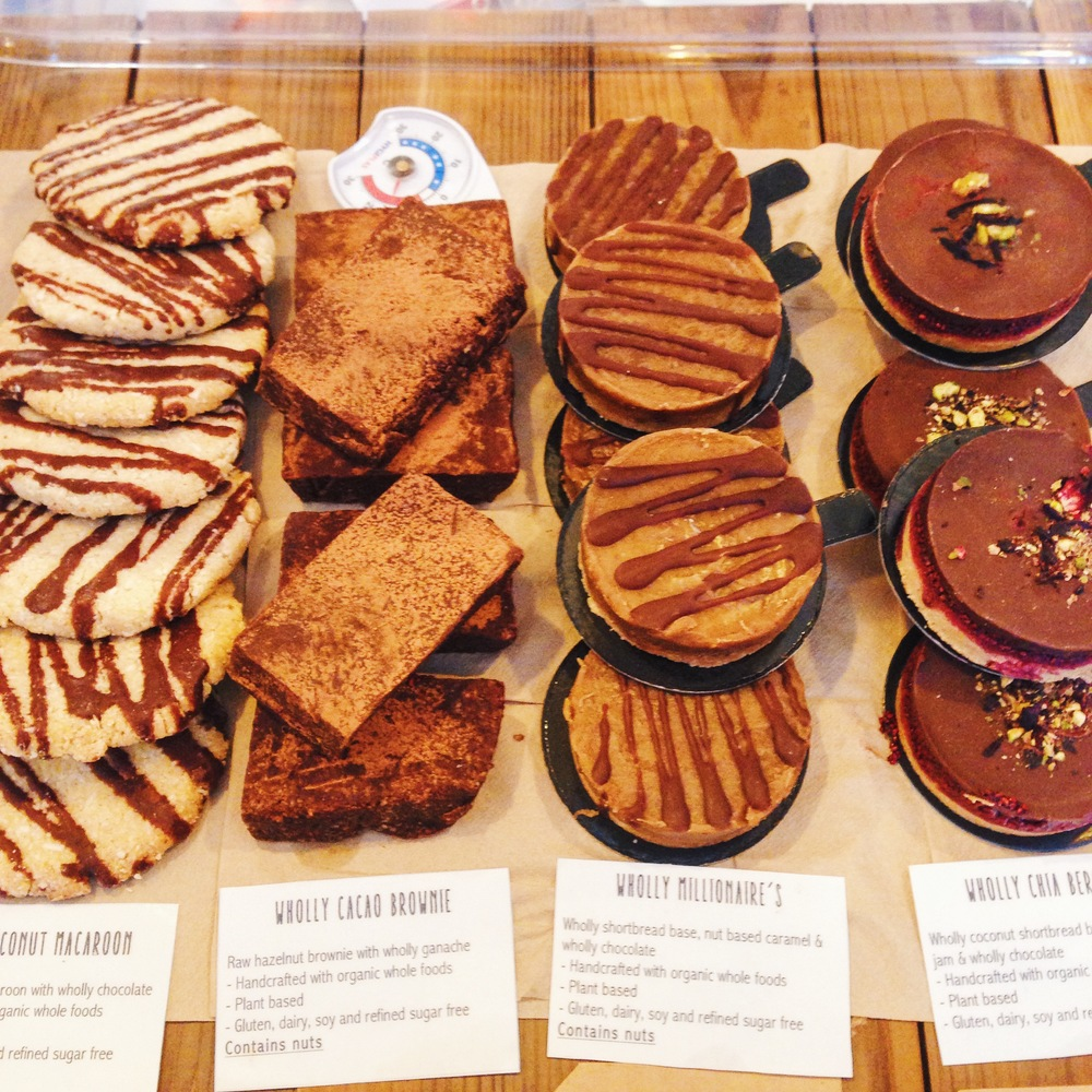 A selection of Wholly Cakes in all their glory - vegan & refined-sugar-free cakes available at the counter