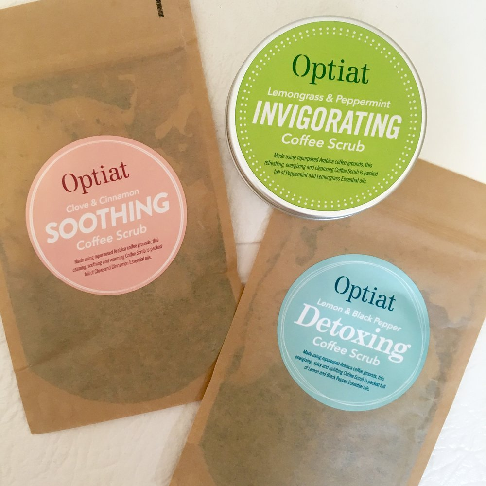 Optiat scrubs come in three varieties: Clove & Cinnamon, Lemongrass & Peppermint and Lemon & Black Pepper.