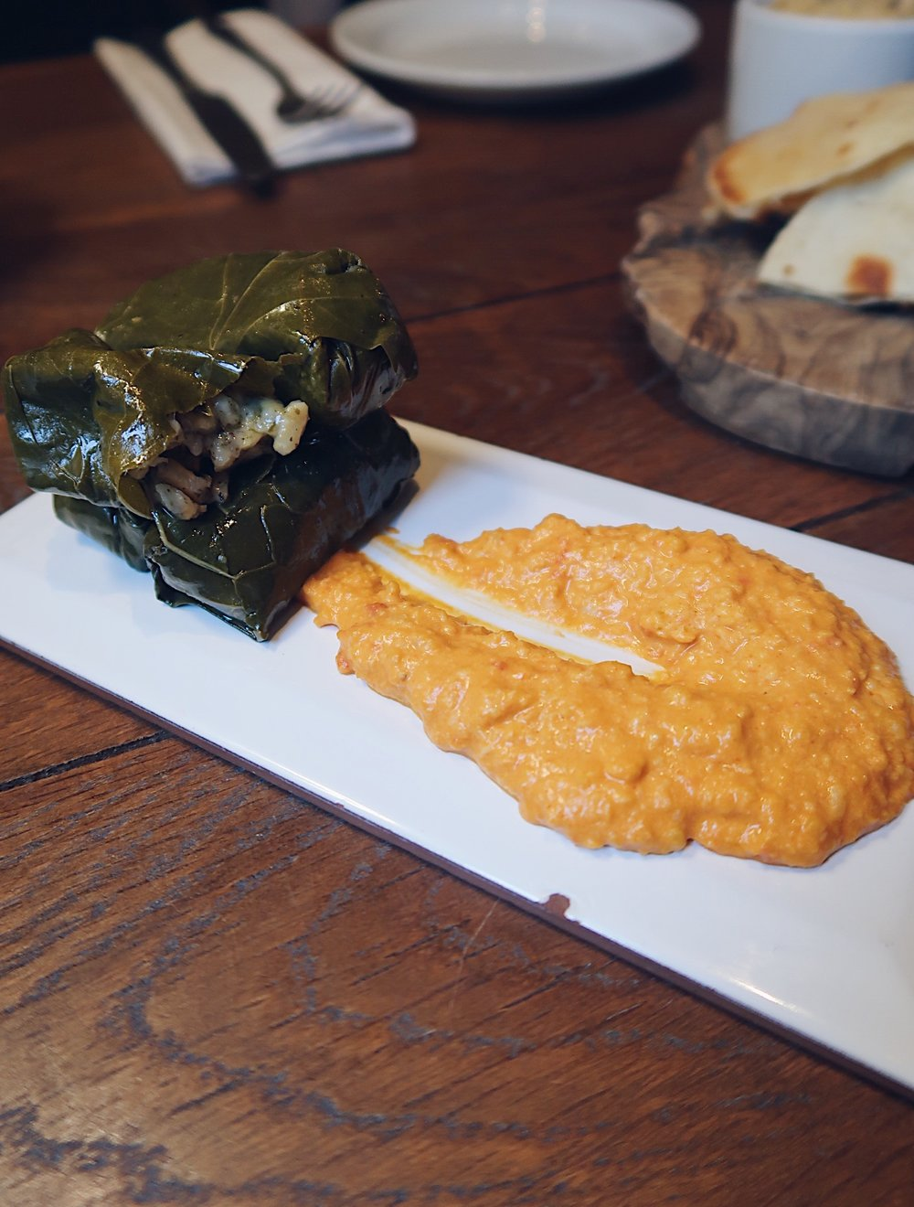 Stuffed vine leaves with hummus
