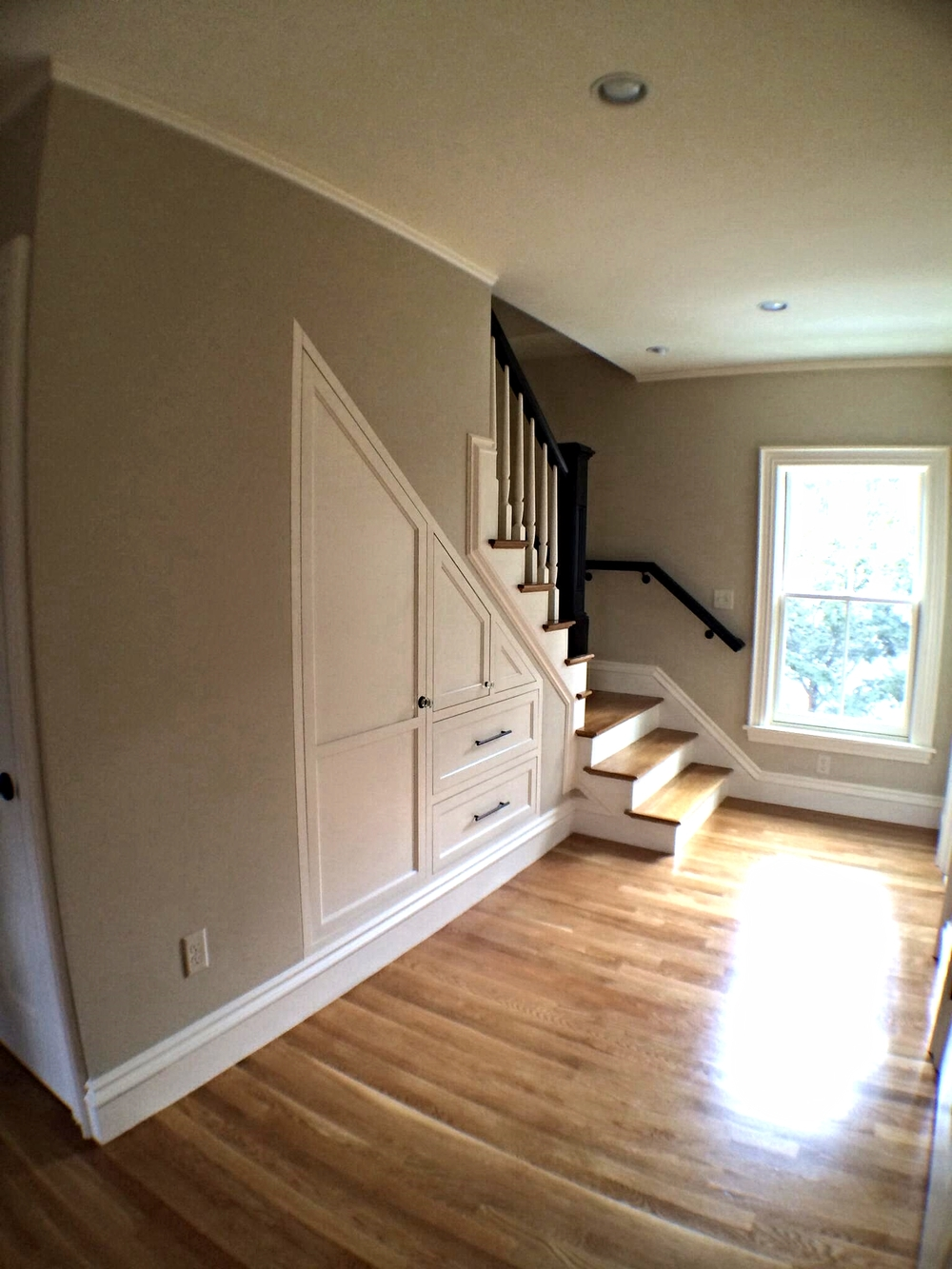 New stairs to 3rd floor with built-ins