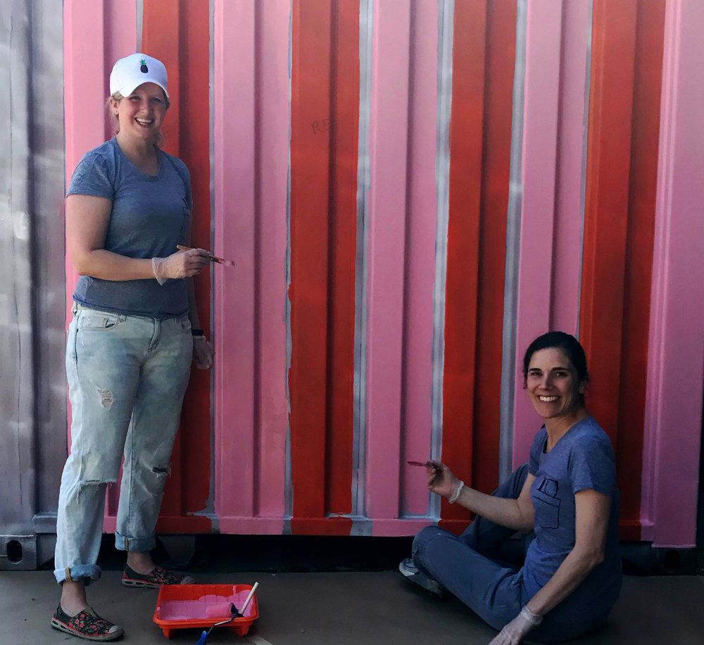 Leo Burnett Chicago employees paint a structure outside of the Off the Street Club in the West Garfield Park neighborhood of Chicago.