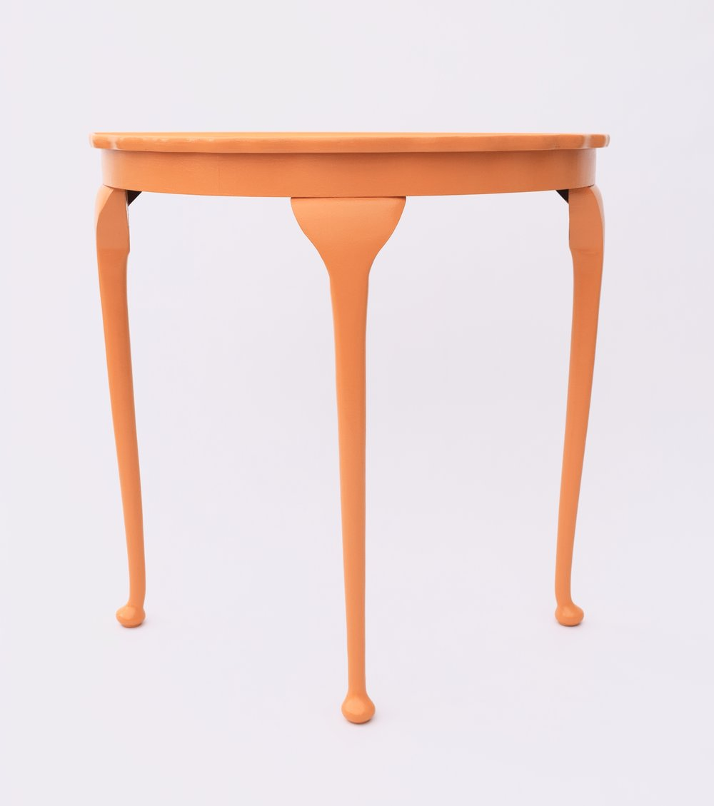 ORANGE DEMI-LUNE TABLE