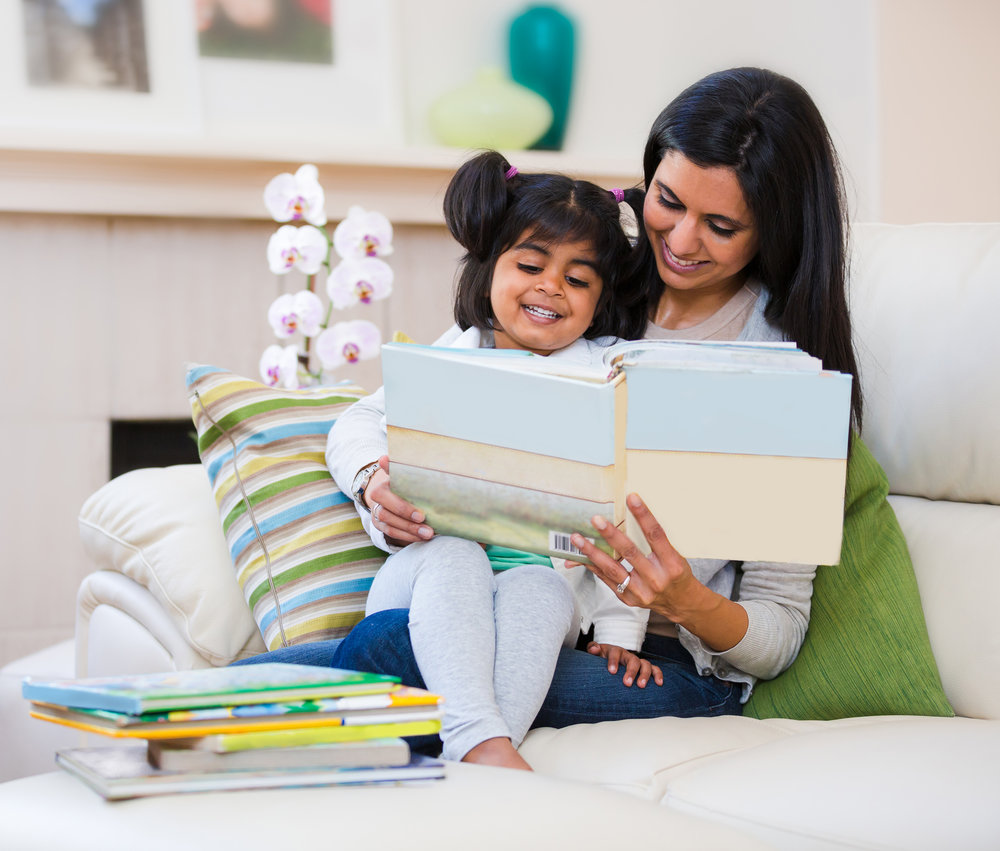 """Mother and daughter reading. Links to """"What We Do"""" page."""