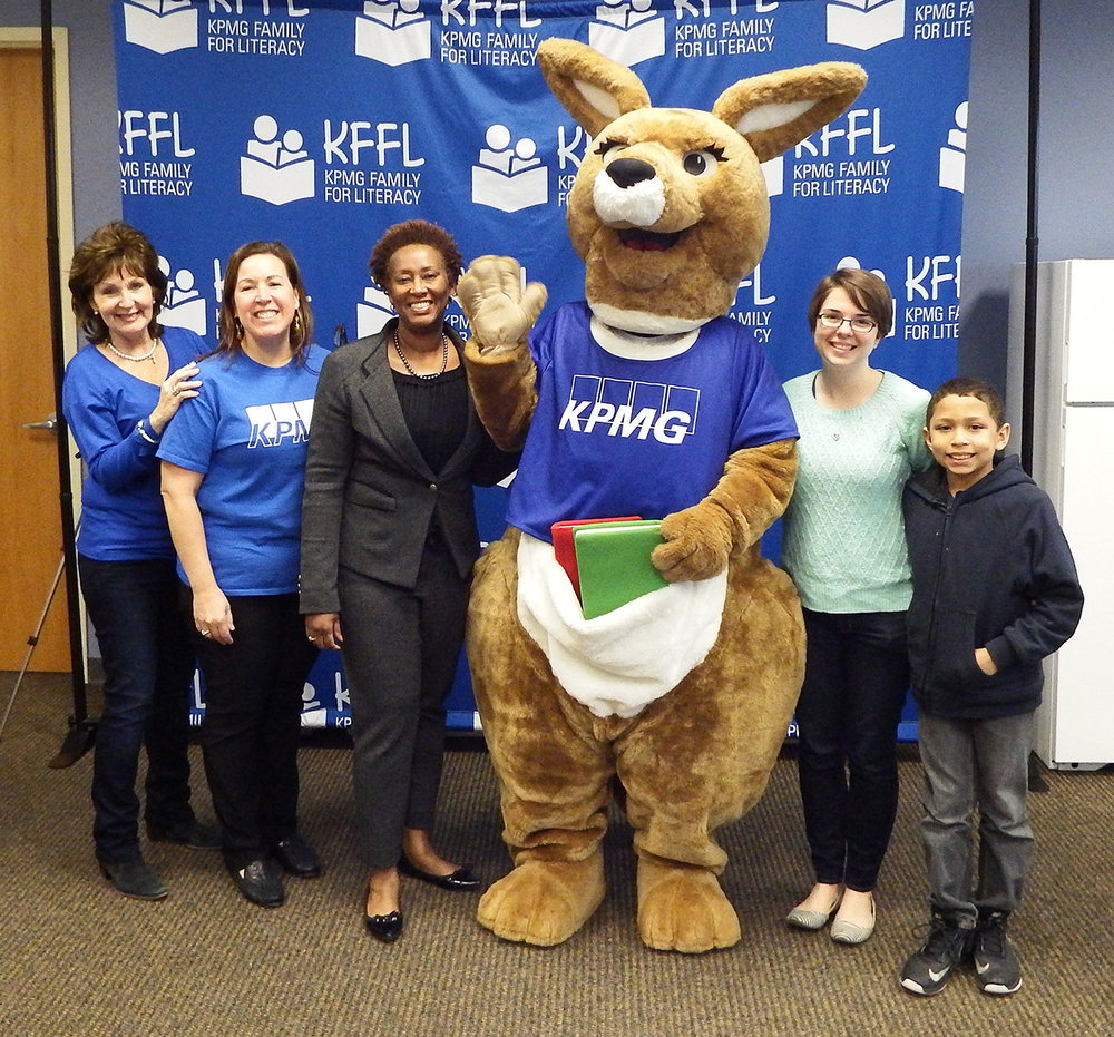 Debbie Ozanus, National KFFL Co-Chair, Karen Vangyia, KPMG Office Managing Partner, Constance Gully, President and CEO, Parents as Teachers, and a teacher and student pause for a photo op with Kiffle, the KFFL Mascot