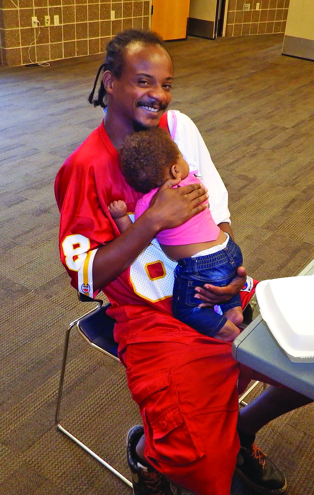 Terrence Trice holds his six-month-old daughter, Tayaina.