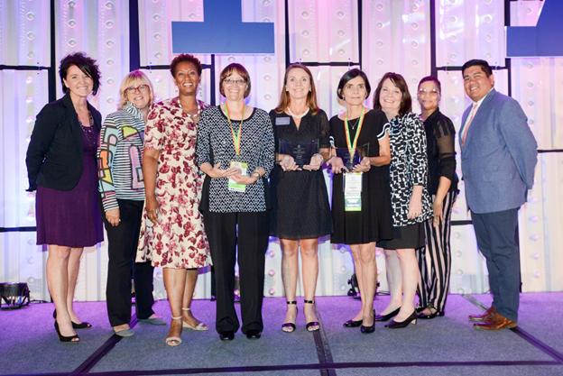 Winners of the Parent Educator of Year awards pose with PAT board members and staff at the 2018 international conference in Phoenix, AZ. From left are: P.J. West, board member; Patricia Kempthorne, board chair; Constance Gully, president/CEO; Parent Educator of the Year recipients Maria Arroyo, The Parenting Center of Lexington, SC; Kristina Gorshe, Catholic Charities Diocese of Pueblo, Pueblo, CO; Cindy Boger, Parents as Teachers of Catawba County Hickory Public Schools, Hickory, NC; Kerry Caverly, VP, program and implementation support; and board members Renee Welch and Francis Vigil.