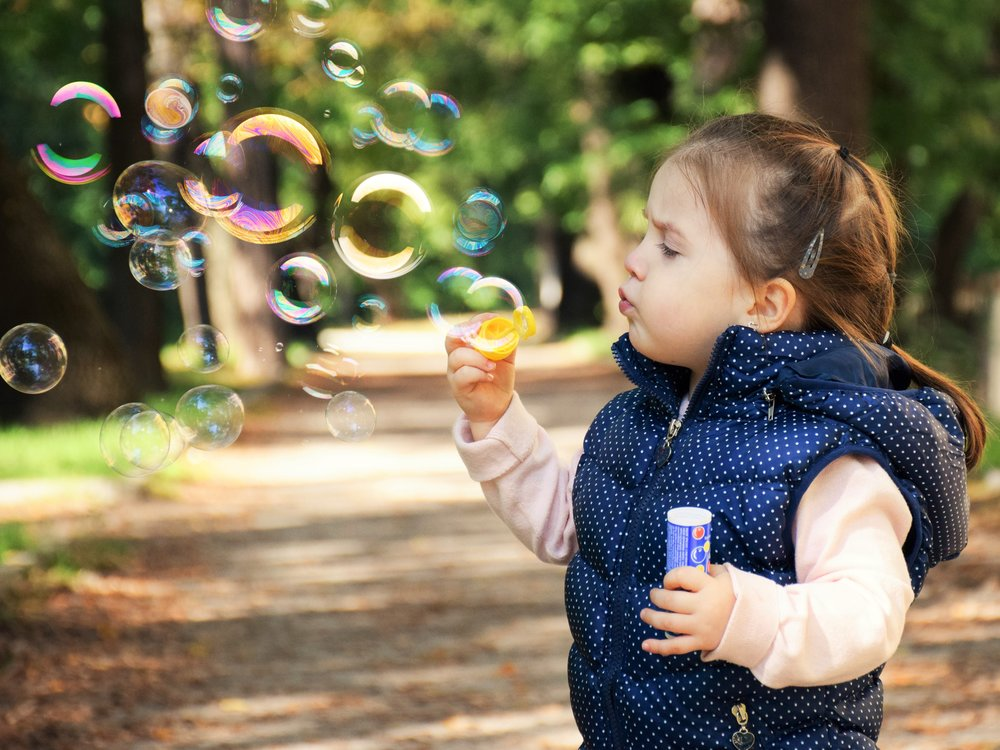 "The word or sign for ""bubbles"" is a great early, concrete motivating word!"
