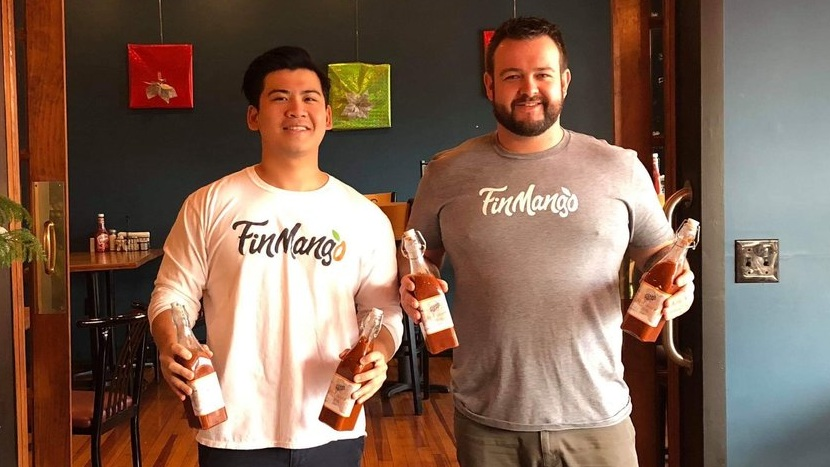 Strategy Director, Jon, and Gram's owner, Jesse, showing off the new hot sauce