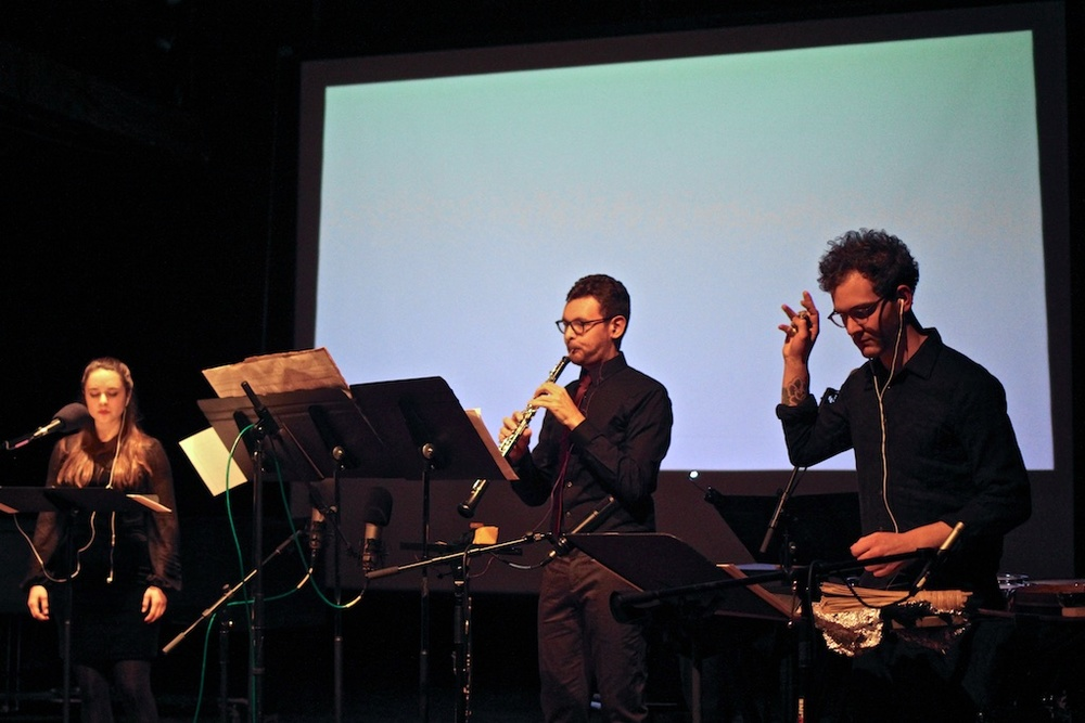 "World premiere of Bethany Younge's ""Bodyscape,"" accompanied by a video. Pictured: Nina Dante, soprano; Jonathan Thompson, oboe; Ryan Packard, percussion."