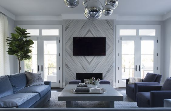 From Morgan Harrison home, love the way the installation of the fireplace marble.  Instead of installing a clean slab, it was cut to create a diamond design.  Case in point how classic materials installed in a creative fashion can take something from beautiful to downright knockout!