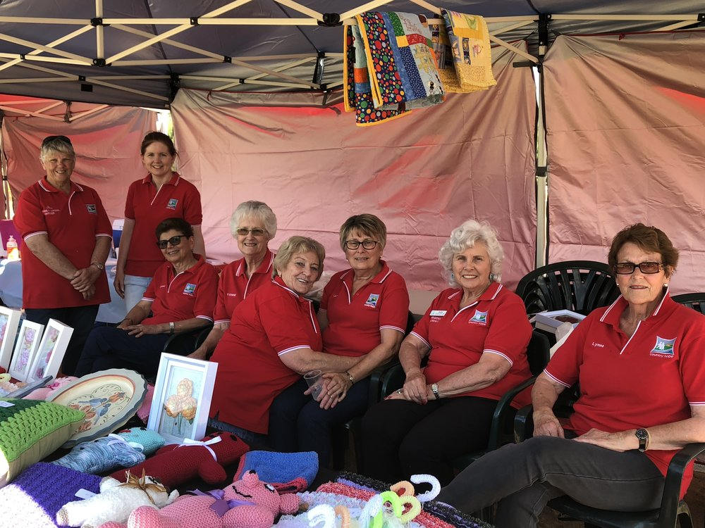 Griffith Garden Festival volunteers resting after a huge day selling raffle tickets, craft & serving meals all day. L to R . Bev, Lauren, Deanna, Yvonne, ( Leeton) Edna, 14/10/17