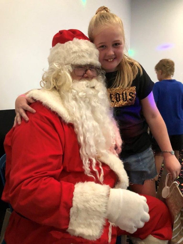 Tekia has a hug from Santa, maybe she is counting on lots of presents on Christmas morning.