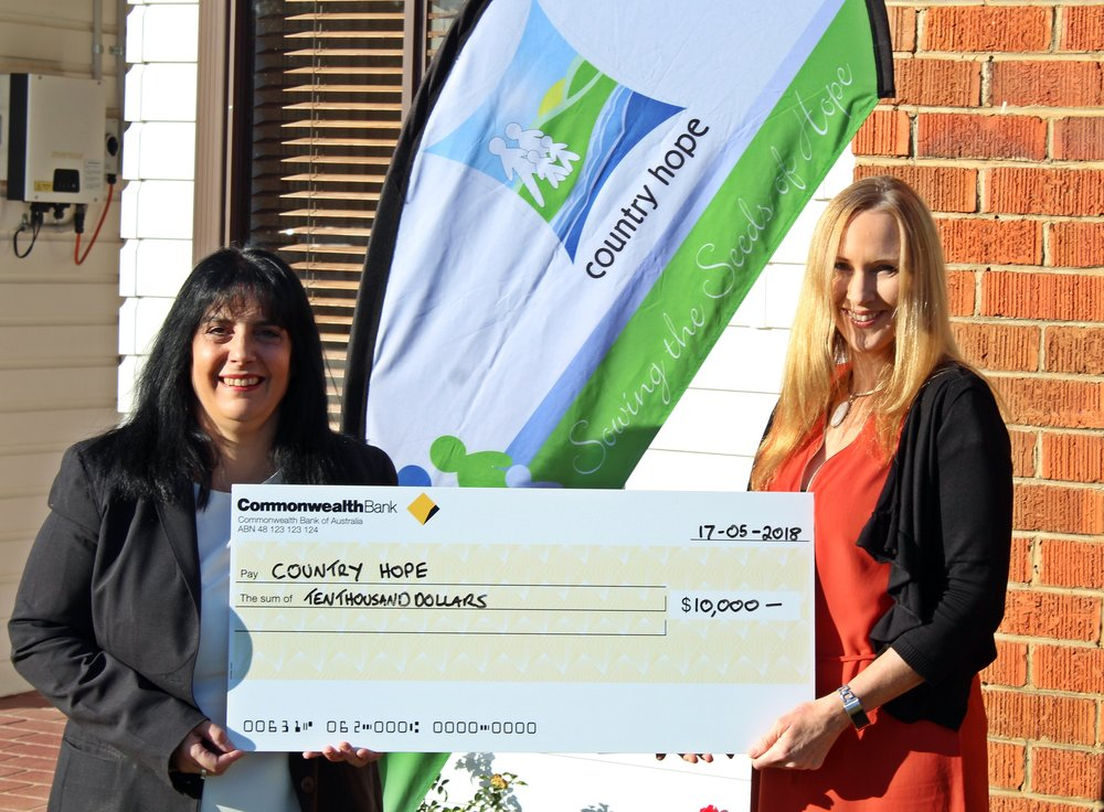 Pictured above:  Commonwealth Bank Staff Member and Country Hope Volunteer Keri Hariman and Nikki Grae receiving the cheque.