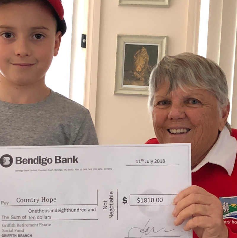 Bev & grandson Kade with the cheque from Griffith Retirement Estate.