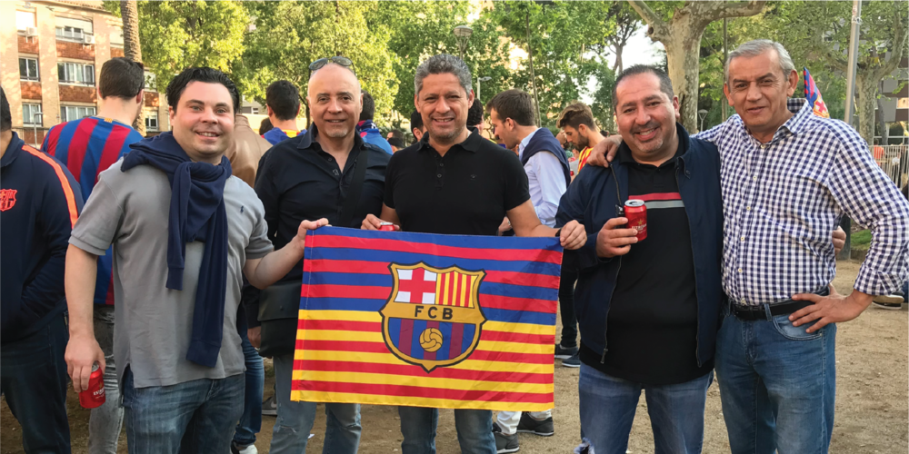 FANS WITH FCB FLAG.png