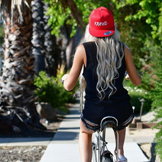 """Santa Cruz was made for Cruzin 😎 @julyajayne reppin The """"Faith"""" Series Snap Back. Get the Grom fitted! Available NOW! 👇🏼 WWW.KRAWLLOCO.COM 10% of apparel profit goes to the kids."""
