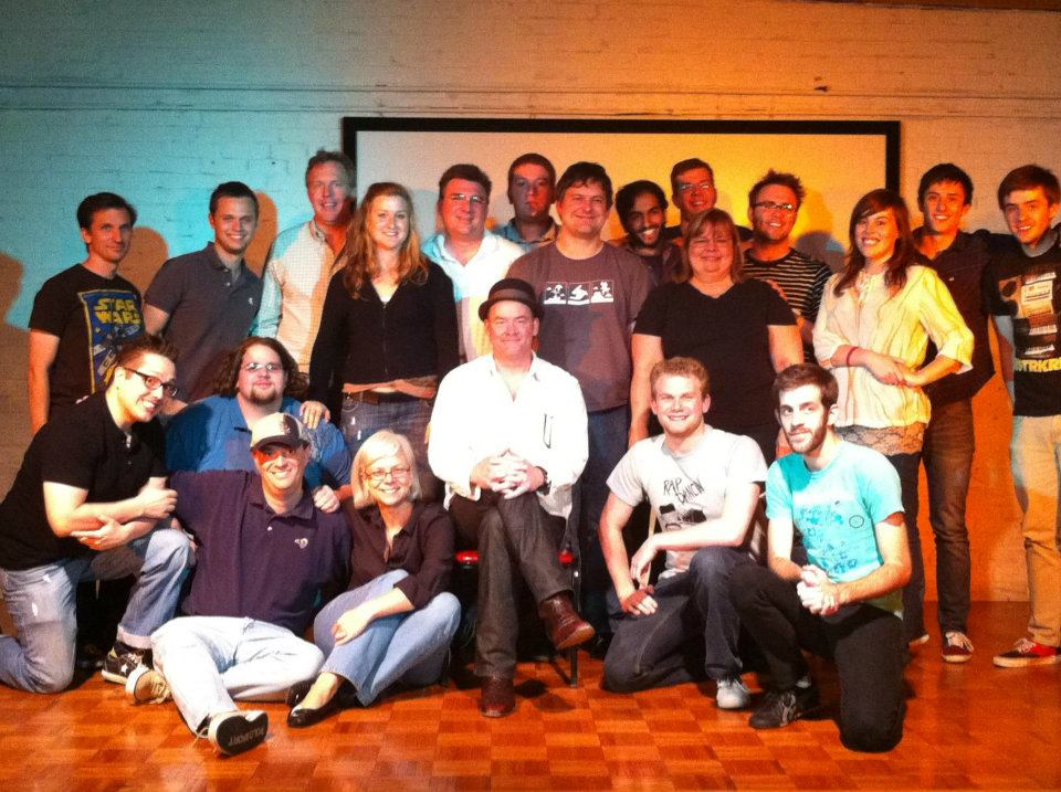 An improv workshop in 2011 with David Koechner (Anchorman, The Office). He told me to cut my hair, so I did. I also lost 100 pounds. That's me in the blue shirt and goatee… -shudders-