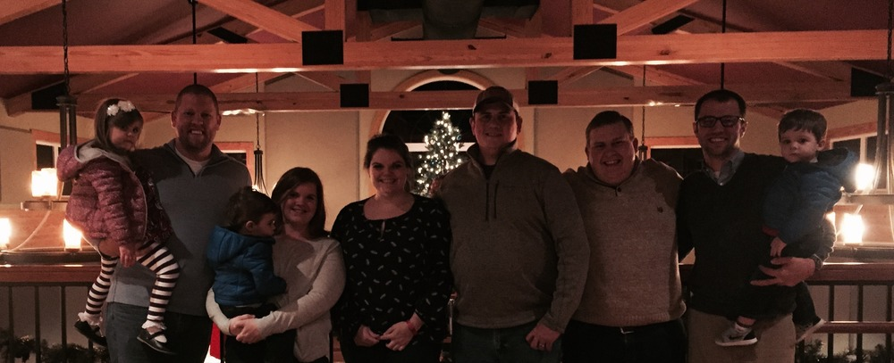 The Planning Committee presents a check to Steven's family at Blue Mountain Brewery, December 2015.  Pictured: (L to R) Avery Short, Josh Deaver, Grayson Short, Ashley Short, Amanda Holcomb, Neil Sandridge, Aaron Schlappi, Nick Short, and Carson Short