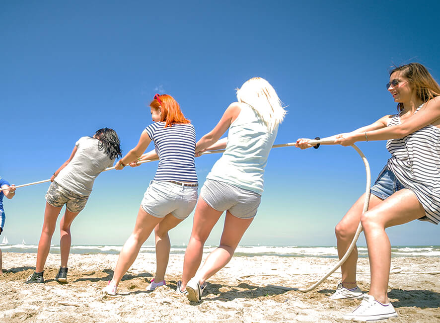 Beach Bonanza - friends playing tug of war.jpg