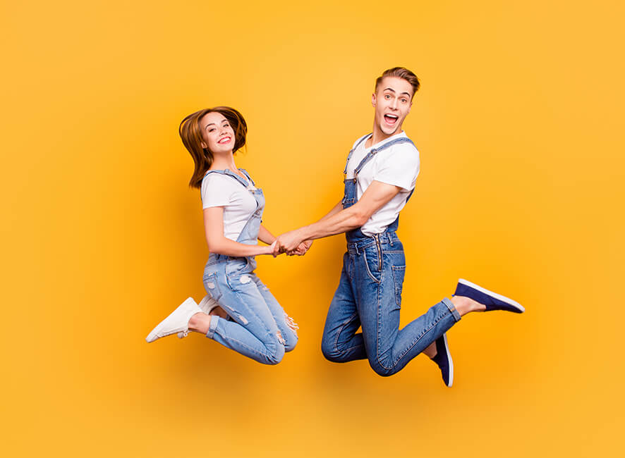 FLP - Quirky couple jumping and holding hands.jpg
