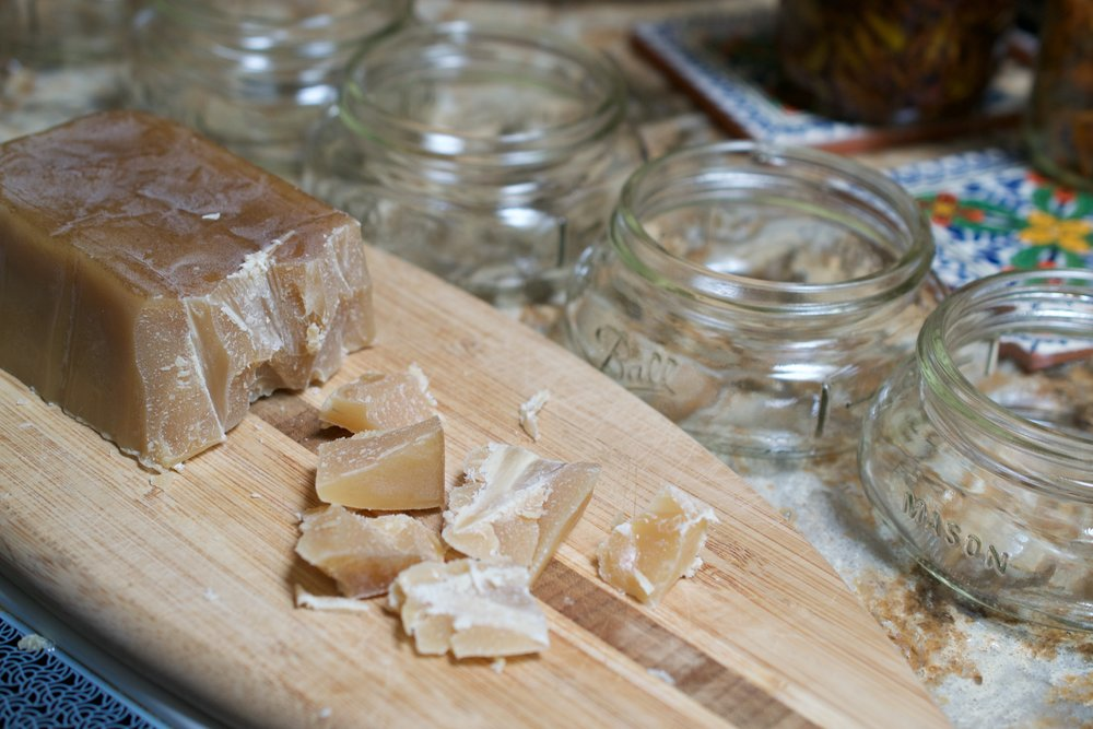 Chunks of beeswax brick shaved off to use to help solidify the oil into the semi-solid state of the salve.