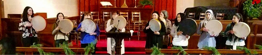 Women frame drummers performing at the Holiday 2017 NY Arabic Orchestra concert