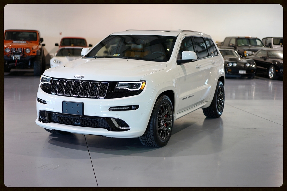 2015 Grand Cherokee SRT....This Cherokee is Heavily Optioned with a Very Rare Color Combo. We Just Installed Brand New Tires..Click for More Info.