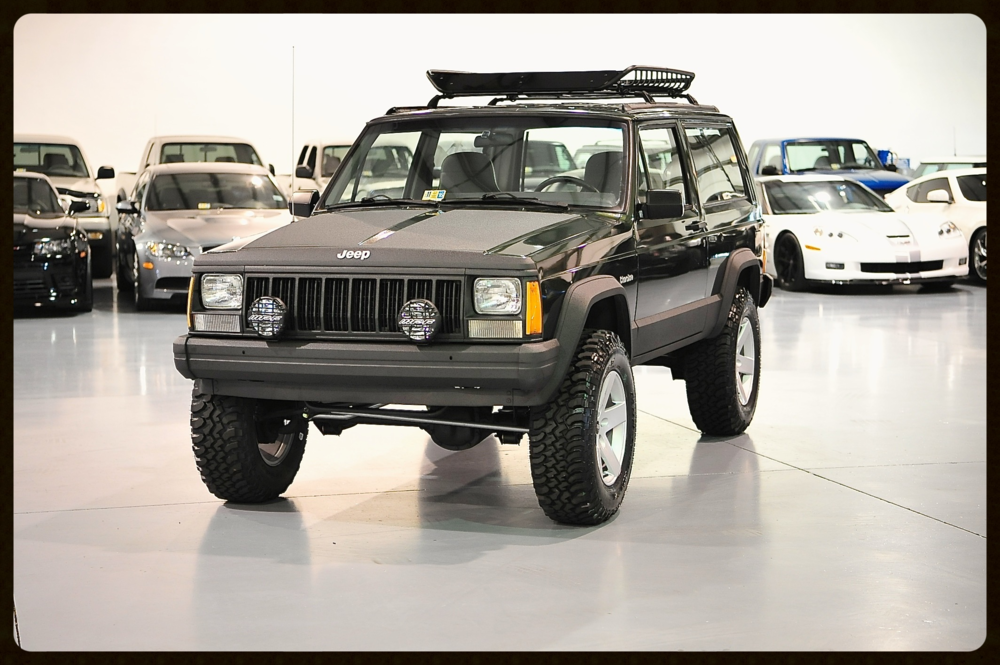 1996 2 Door with gorgeous Moss Green Peal Paint. This XJ is absolutely Classy and Timeless yet Rugged. Click Here to View More Photos and Video