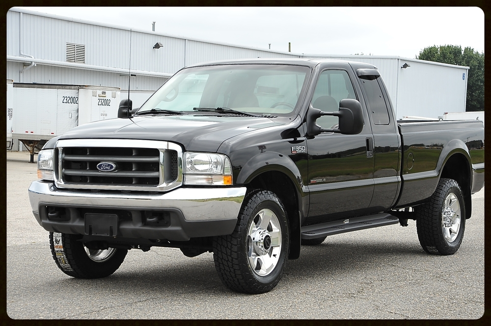 "2002 Ford F350 7.3 DIESEL WITH ONLY 56K ORIGINAL MILES.....We just installed brand new 20"" Tires and Ford OEM Wheels. Gorgeous Truck"