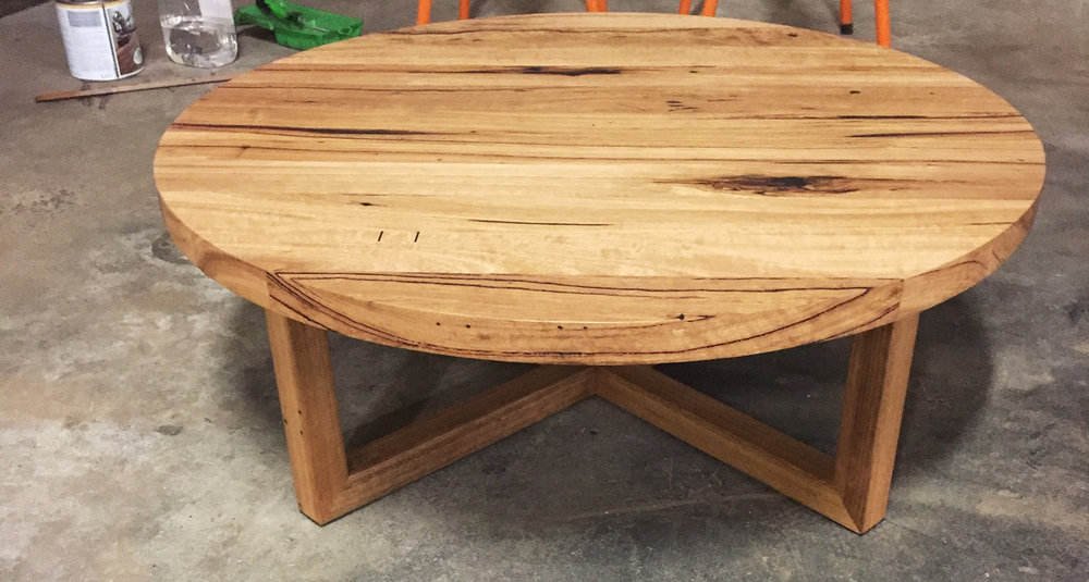 Mariel round coffee table with x legs Retrograde Furniture