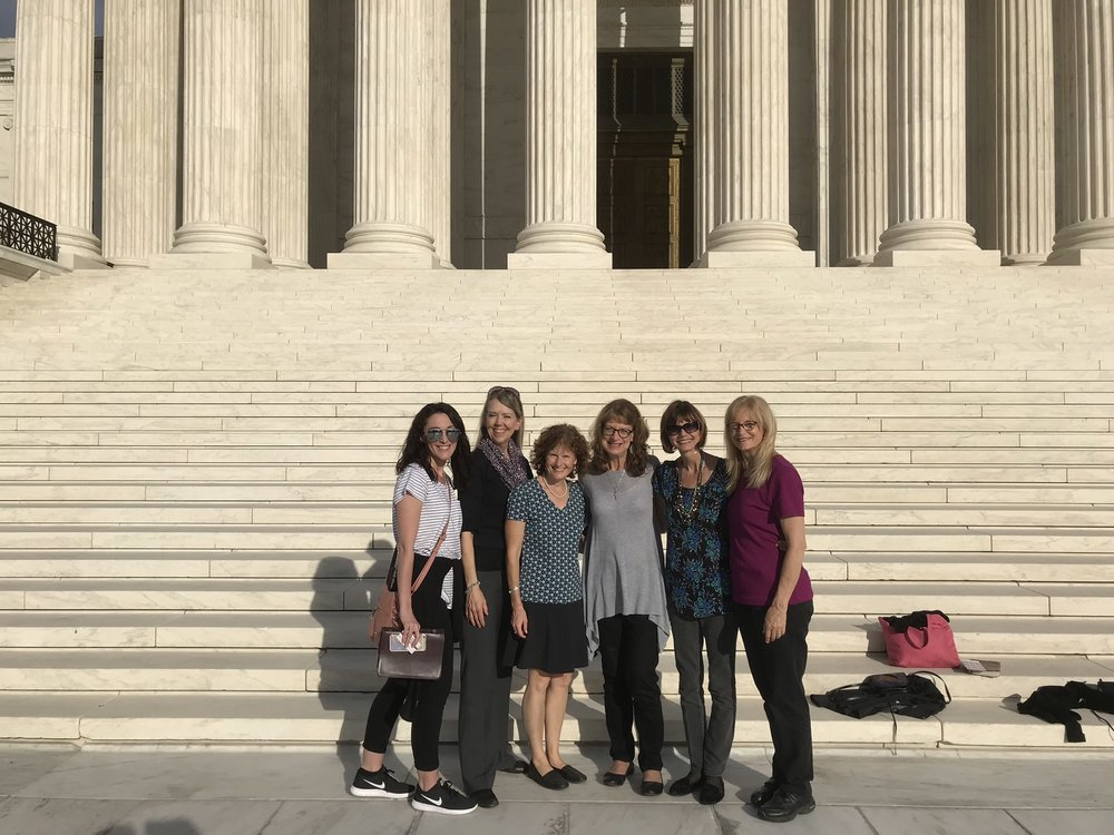 The intercessors we 'bumped into' on the steps of the Supreme Court.