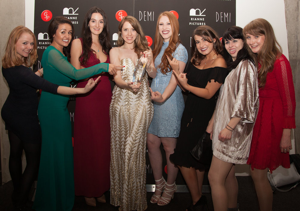 Effy Willis, Hayley Wilson, Kerenza Qayum, Caris Rianne, Hannah Bury, Eva Crawford, Elinor O'Leary and Jayde Manning with the Royal Reel Award from the Canadian International Film Festival which Rianne won in the First Time Filmmakers Category.