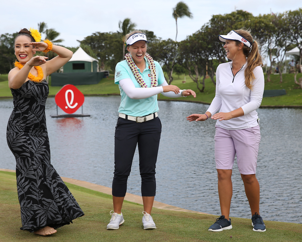 Canadian Brooke Henderson (center left) and her caddie/sister Brittany celebrated Brooke's victory at the 2018 LOTTE Championship at Ko Olina Golf Club on April 14, 2018 in Kapolei, Hawaii. (Photo by Marco Garcia)