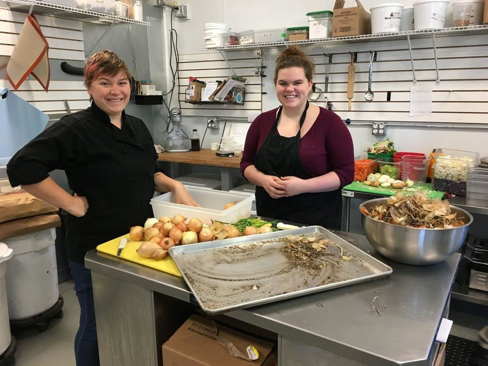 """""""Just knowing what it's like to work,"""" Harpswell Coastal Academy junior Karli Clark, right, said, is a rare opportunity afforded in the New Beet Market kitchen. She and program manager Alida Belcher, left, processed onions Monday, Nov. 28, for a meal that will feed 50 of Clark's classmates."""