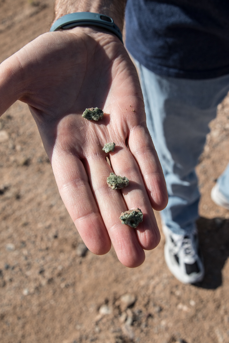 A visitor holds Trinitite fragments, WSMR, New Mexico.