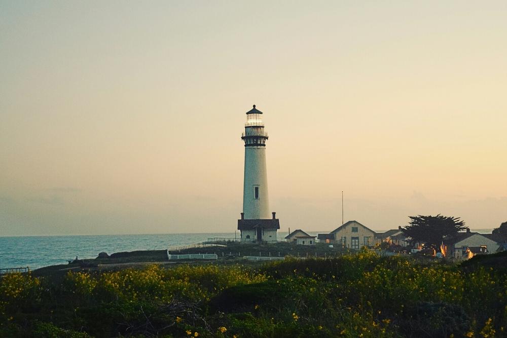 A lighthouse at sunset near Rockaway Beach, CA.