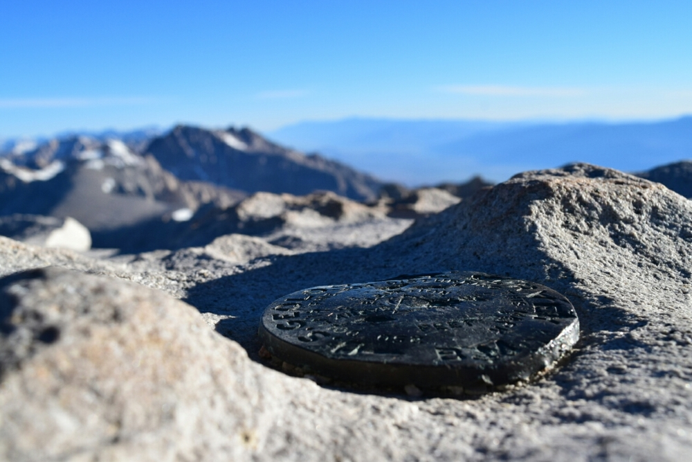 The USGS survey marker on top of Mt. Whitney