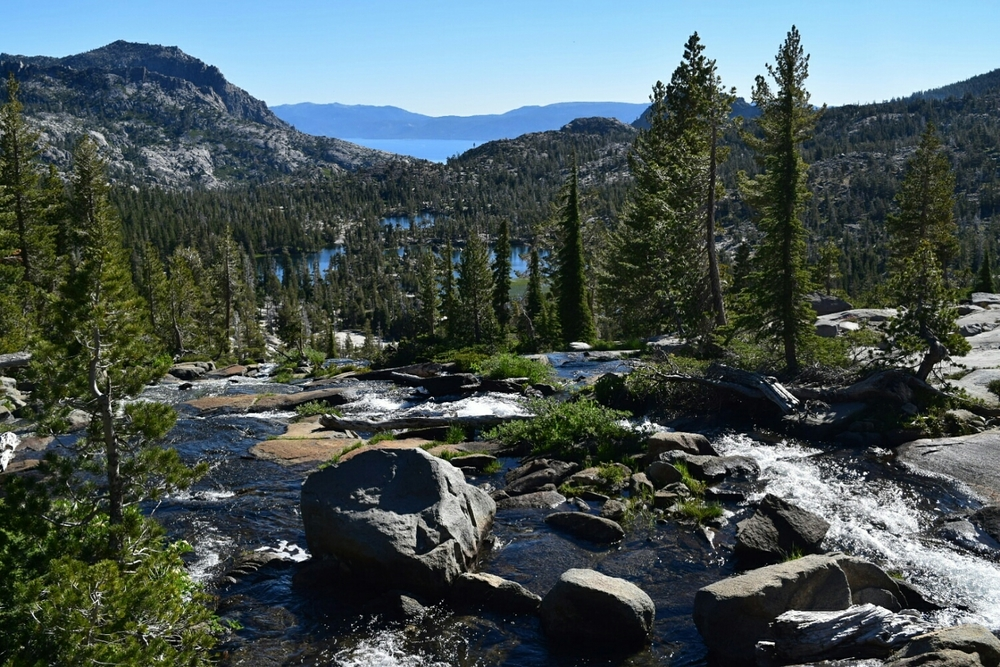Water flows from Fontanillis Lake in the Desolation Wilderness to Lake Tahoe in the distance.