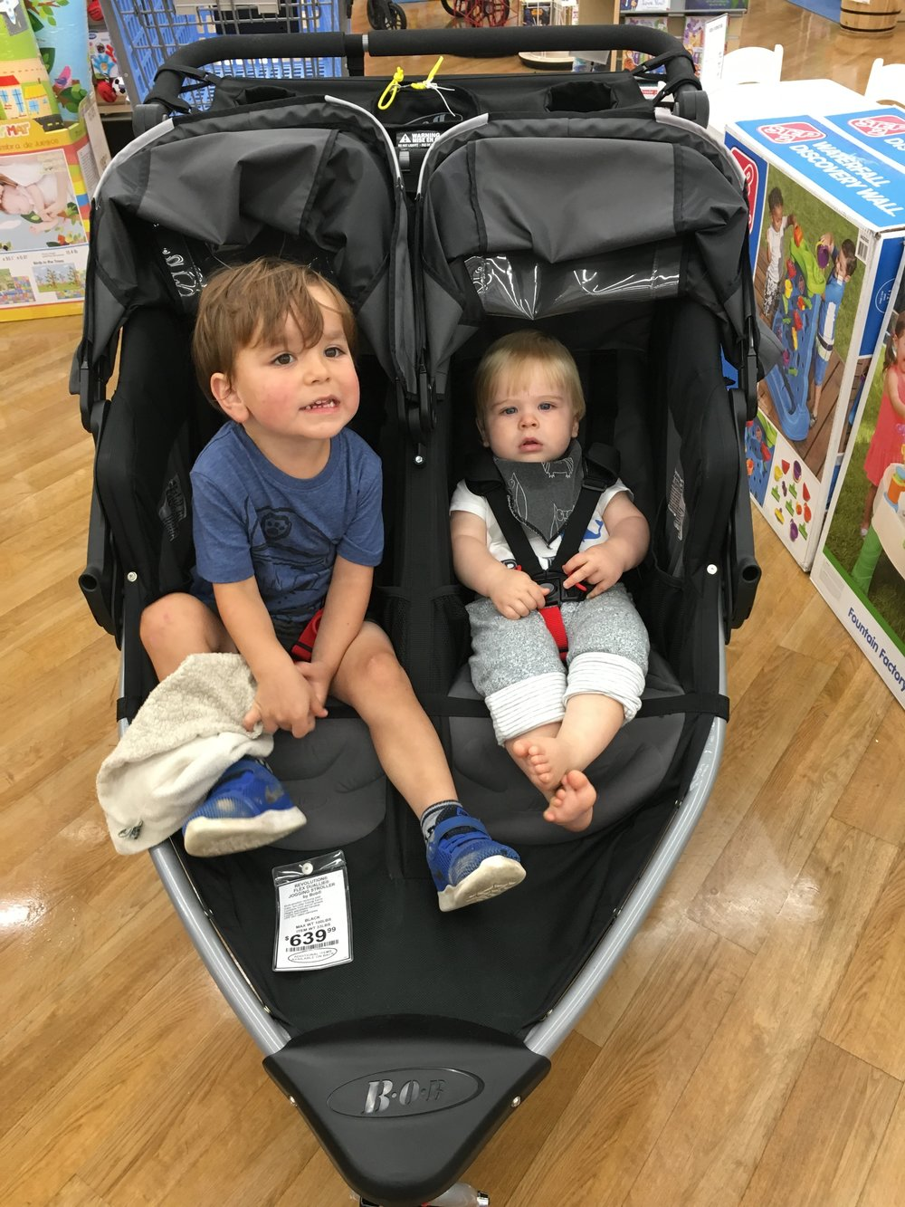 Testing the BOB Double stroller out in store. They look thrilled! Ha!