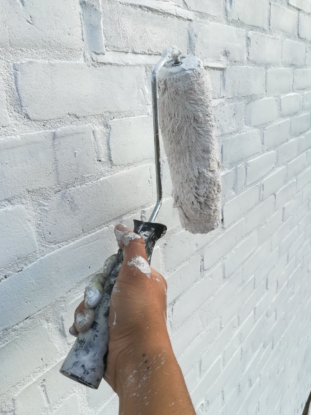 Must-haves - The next day, I applied a brilliant white masonry primer using a roller with a sleeve specifically designed for rough surfaces and a selection of masonry brushes - they make the application so much easier.