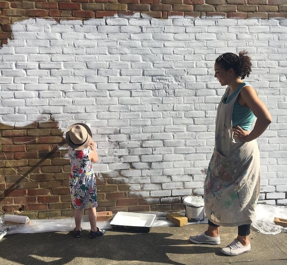 Welcome helpers - - no matter the size! Painting a very large wall plain white is far more fun and goes a lot quicker with help.You may need two coats of white, as I did. This is doable in one (long, sunny) day. And THEN you can move on the exciting part - adding colour!
