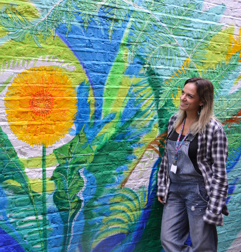 St Mungo's Hammersmith Assistant Project Manager, Claire, viewing the wall midway through painting.