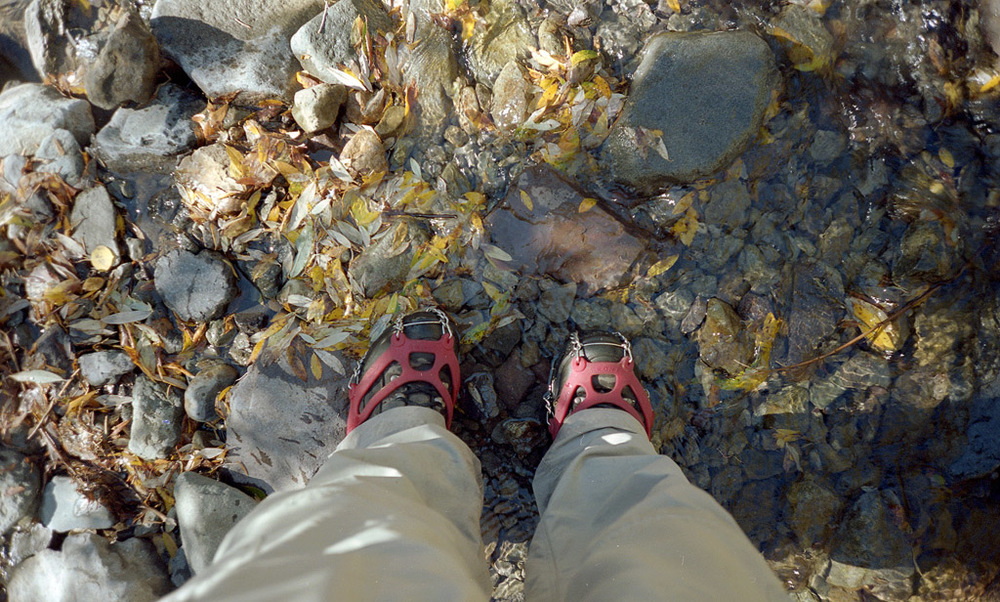 My ice cleated boots as I walk through a stream