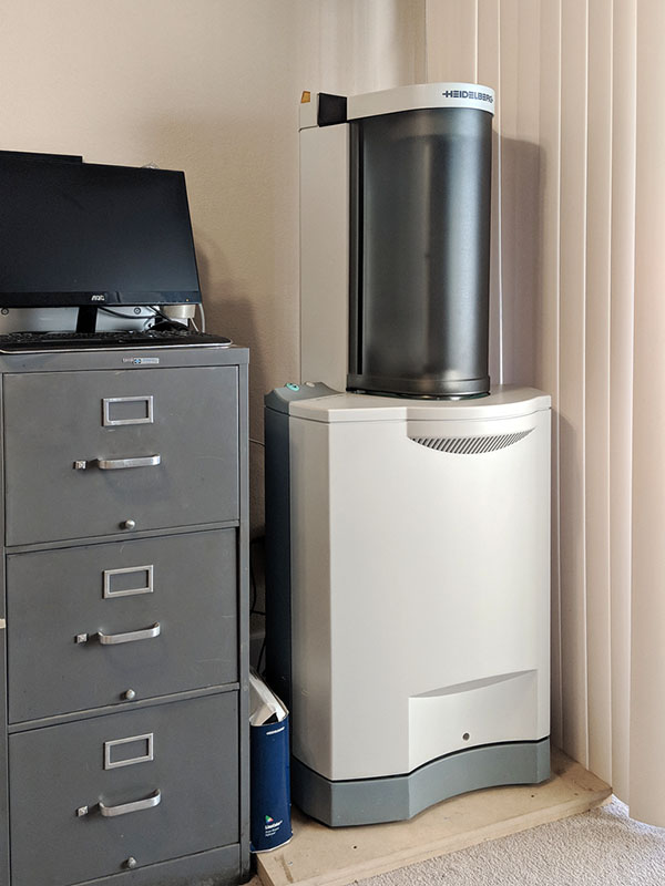 Tango Drum scanner with PowerMac hiding behind monitor on filing cabinet