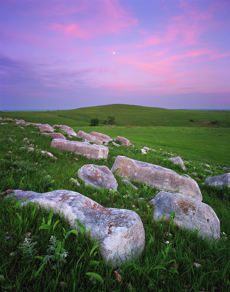 """Flint Hills Moonrise"" - The moon rises over the namesake stones of the Flint Hills at sunset.  These large outcroppings dot the rich green landscape of rolling grasslands.  Prints Available."