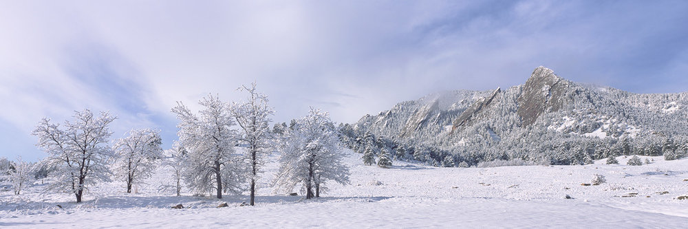 """""""Flatiron Snow"""" - A spring snowstorm covers the Boulder flatirons and the surrounding forest in crisp white powder. Prints Available."""