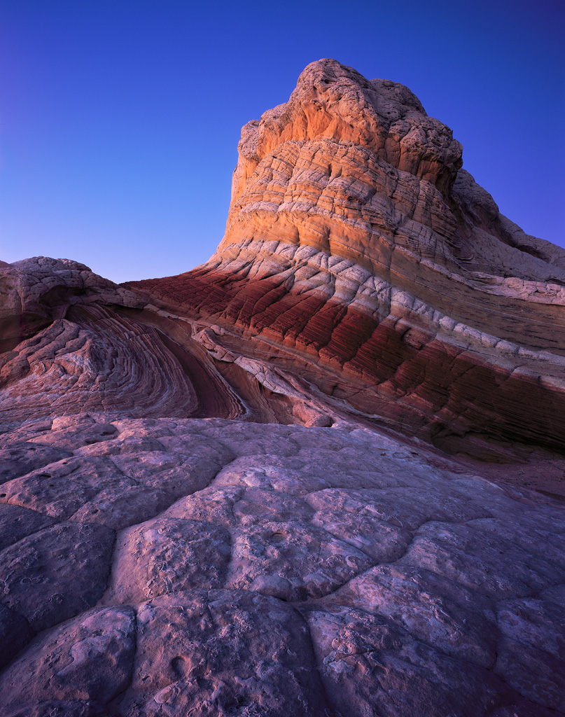 """Twilight Rainbow Rock"" - Provia 100f 4x5, 75mm lens - 5 minutes at f22, warming filter. I was able to set up this composition while it was still light out, then waited until well past sunset. Be patient! The glow on these rocks was not impressive until it was surprisingly dark out, well past sunset."