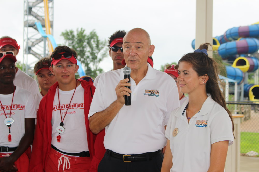 Ed Hart (speaking) and Aquatics Manager Maddie King (far right), who oversees the lifeguards.